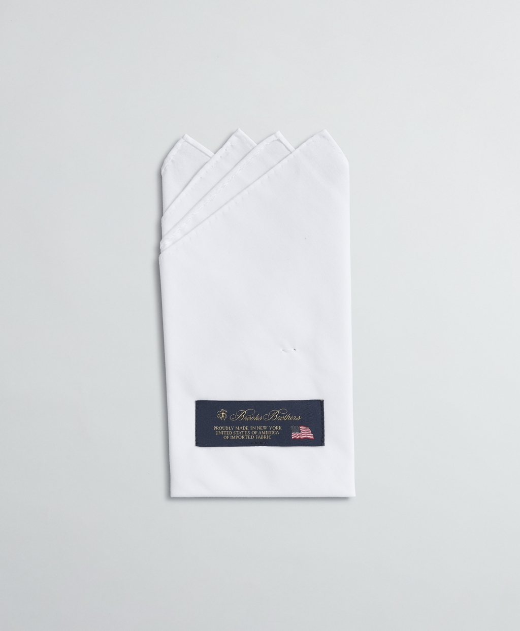 Pre-folded pocket square, 4-point fold. 100% cotton. Made in USA.